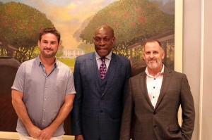 Dan Cheeseman, left with Frank Bruno, and Stephen Ayling of Orchid Palm Homes