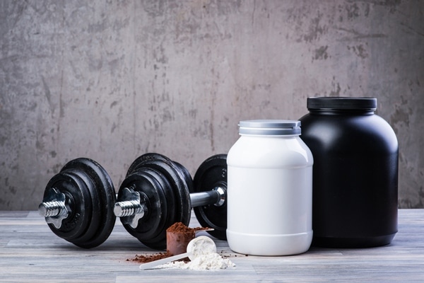 protein-supplements-and-dumbbells